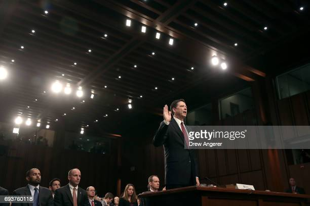 Former FBI Director James Comey is swornin before testifying before the Senate Intelligence Committee in the Hart Senate Office Building on Capitol...