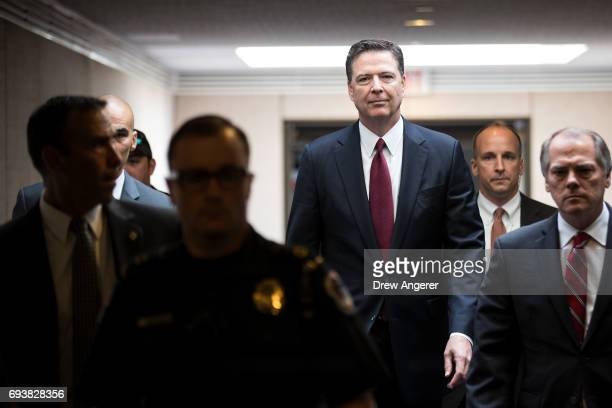 Former FBI Director James Comey leaves a closed session with the Senate Intelligence Committee in the Hart Senate Office Building on Capitol Hill...