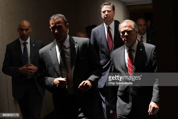 Former FBI Director James Comey moves from an open hearing to a closed hearing during a break in testimony before the Senate Intelligence Committee...