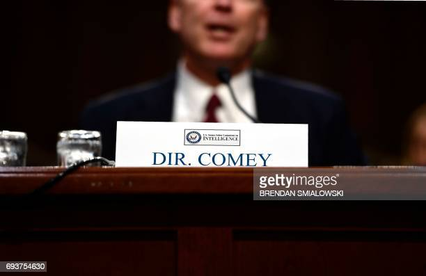 Former FBI Director James Comey testifies during a US Senate Select Committee on Intelligence hearing on Capitol Hill in Washington DC June 8 2017 /...