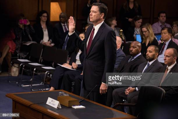 Former FBI Director James Comey was sworn in before he testified in front of the Senate Intelligence Committee on his past relationship with...