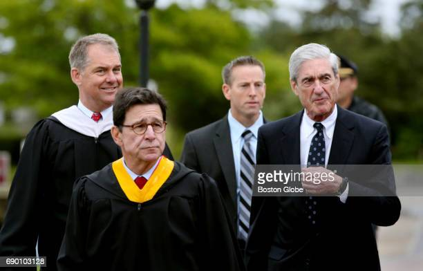 Former FBI director Robert S Mueller III right joins Head of School John H Quirk left and Board of Trusties Chair Carmine Martignetti front walking...