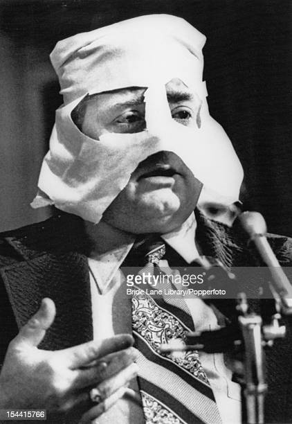 Former FBI informer Gary Thomas Rowe wearing a hood to conceal his identity as he gives evidence to a Senate Select Committee on Intelligence...