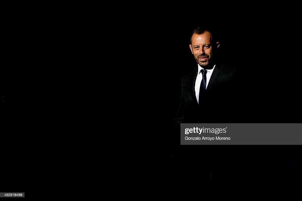Former FC Barcelona president <a gi-track='captionPersonalityLinkClicked' href=/galleries/search?phrase=Sandro+Rosell&family=editorial&specificpeople=2363208 ng-click='$event.stopPropagation()'>Sandro Rosell</a> arrives at Spain's High Court on July 22, 2014 in Madrid, Spain. Former FC Barcelona president <a gi-track='captionPersonalityLinkClicked' href=/galleries/search?phrase=Sandro+Rosell&family=editorial&specificpeople=2363208 ng-click='$event.stopPropagation()'>Sandro Rosell</a> declares at Spain's High Court after being impeached by judge Pablo Ruz in his investigation of the Catalan clubs' signing of Brazilian player Neymar Da Silva in June 2013. Rosell is suspected in being involved in hiding the full cost of Neymar's transfer fee from Brazilian club Santos and thereby avoiding an estimated 9.1 million euros in tax.