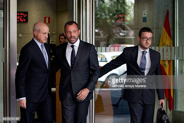 Former FC Barcelona president Sandro Rosell leaves Spain's High Court in company of his lawyers on July 22 2014 in Madrid Spain Former FC Barcelona...
