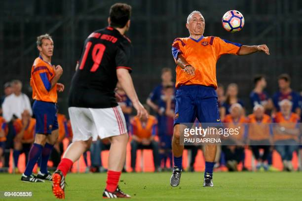 Former FC Barcelona's Bulgarian forward Hristo Stoichkov controls the ball during a tribute match against SL Benfica at the Camp Nou stadium in...