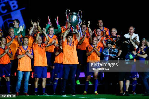 Former FC Barcelona's defender Jose Ramon Alexanko holds a trophy during a tribute match against SL Benfica at the Camp Nou stadium in Barcelona on...