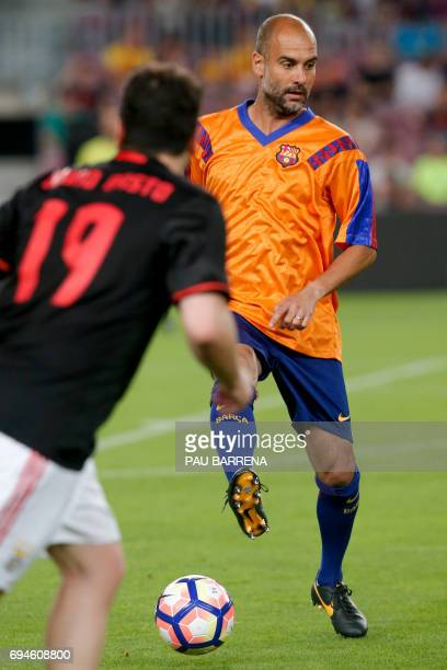 Former FC Barcelona's midfielder Josep Guardiola controls the ball during a tribute match against SL Benfica at the Camp Nou stadium in Barcelona on...