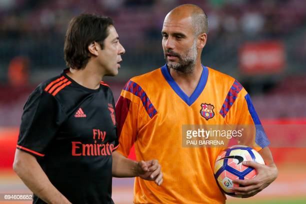 Former FC Barcelona's midfielder Josep Guardiola speaks to former Benfica's midfielder Rui Costa during a tribute match against SL Benfica at the...