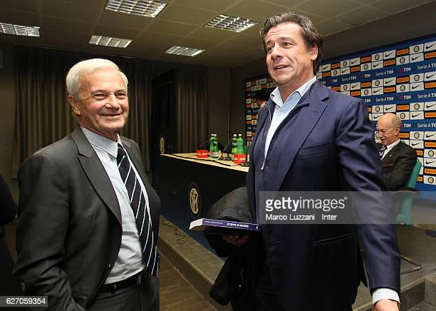 Former FC Internazionale coach Luigi Simoni speaks to Nicola Berti during a press conference to present his biography 'Simoni si nasce Tre vite per...