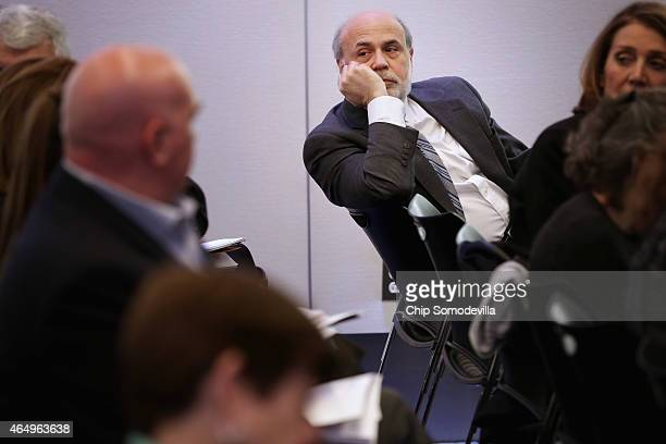 Former Fed Chairman Ben Bernanke attends and event at the Brookings Institution March 2 2015 in Washington DC Bernanke participated in a series of...