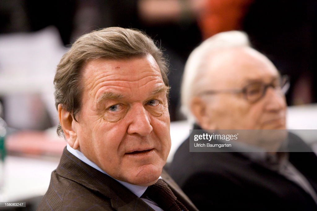 Former Federal Chancellor Gerhard Schroeder (SPD) und Egon Bahr (SPD) at the SPD federal party convention on December 9, 2012 in Hanover, Germany. The SPD is convening to set its policy course for the next year and to celebrate Steinbrueck, who will run for chancellor in elections set for 2013.