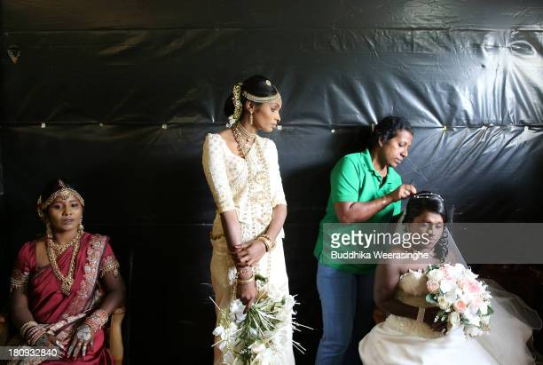 Former female Tamil rebel Premarathnam Suganthini 19 years old looks over to other former female rebels as they are dressed ahead of a wedding...