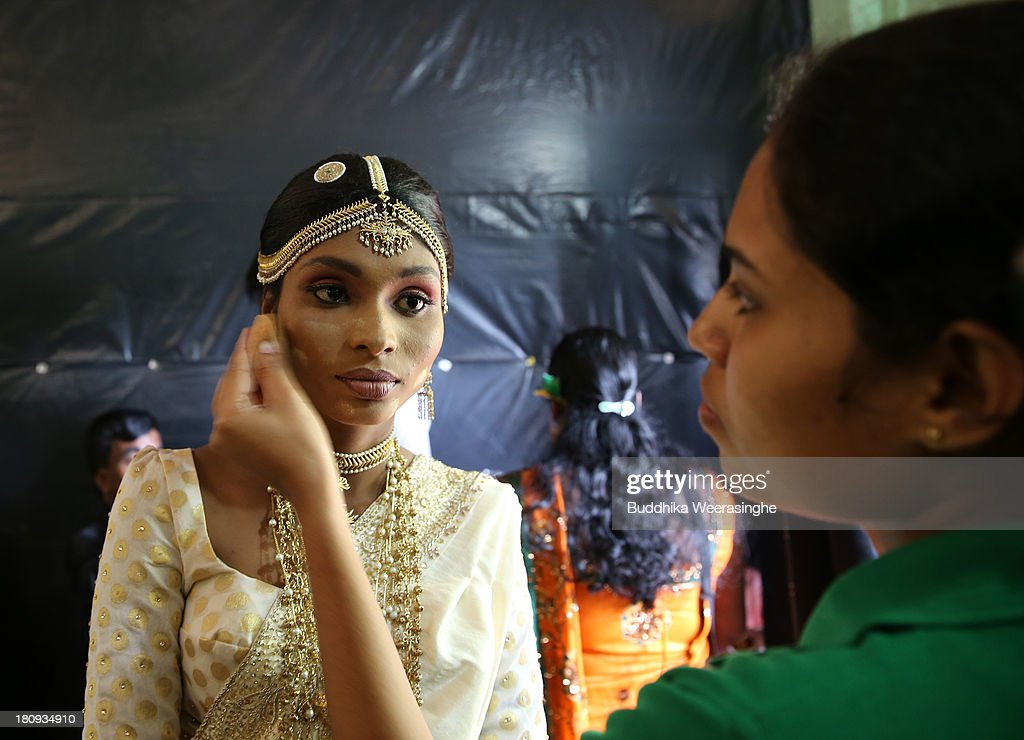 Former female Tamil rebel, Premarathnam Suganthini (C), 19 yeasr old, as her make-up done as she prepares ahead of a wedding ceremony at the Civil Defence Force military camp on September 18, 2013 in Vishwamadu, Sri Lanka. The former female Tamil rebel and a Sinhalese military officer were legally married today in Sri Lanka's war-torn Northern province. Sri Lanka suffered through a 26-year civil war between the Tamil Tigers and the Sri Lankan military which ended in 2009. On September 21 Sri Lankans of the Northern Province will head to the polls for provincial council elections for the first time since the conflict began.