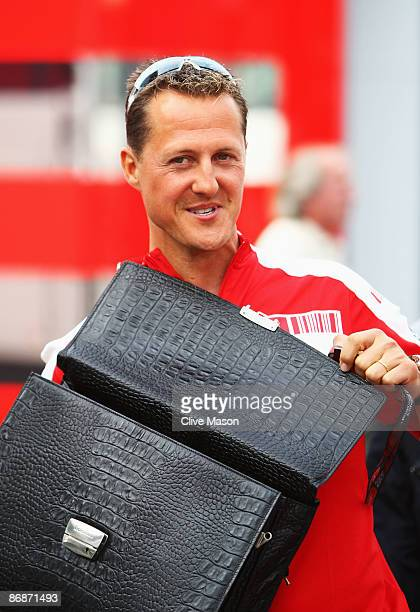 Former Ferrari F1 World Champion Michael Schumacher of Germany is seen in the paddock following qualifying for the Spanish Formula One Grand Prix at...