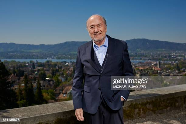 TOPSHOT Former FIFA president Sepp Blatter poses during a photo session past the city of Zurich after an interview with news agencies on April 21...