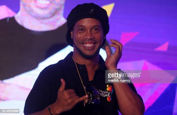 Former FIFA World Brazilian professional footballer Ronaldinho gestures during a press conference to announce the second season of the Premier Futsal...
