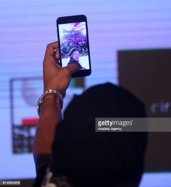 Former FIFA World Brazilian professional footballer Ronaldinho take a selfie with press members during a press conference to announce the second...