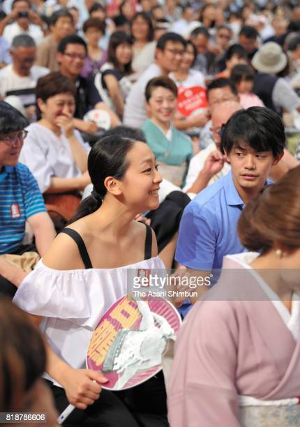 Former figure skaters Mao Asada and Takahiko Kozuka enjoy sumo bouts during day eleven of the Grand Sumo Nagoya Torunament at Aichi Prefecture...