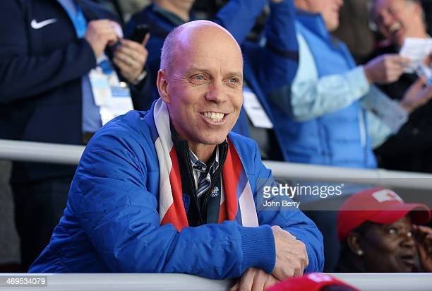 Former figure skating champion Scott Hamilton of USA attends the Men's Ice Hockey Preliminary Round Group A game between Russia and USA on day eight...