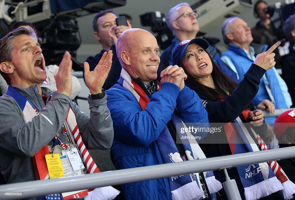 Former figure skating champions Todd Eldredge, Scott Hamilton and Kristi Yamaguchi of USA attend the Men's Ice Hockey Preliminary Round Group A game between Russia and USA on day eight of the Sochi 2014 Winter Olympics at Bolshoy Ice Dome on February 15, 2014 in Sochi, Russia.