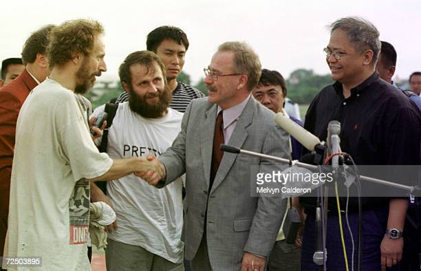 Former Finish hostage Risto Vahanen left is greeted by Finnish envoy Raimo Anttola upon his arrival at Zamboanga Philippines following his release by...