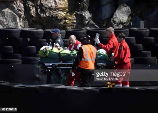 Former Finnish Formula One driver Jyrki Jarvilehto formerly known as JJ Lehto is stretchered off after he was injured during the time trials of the...