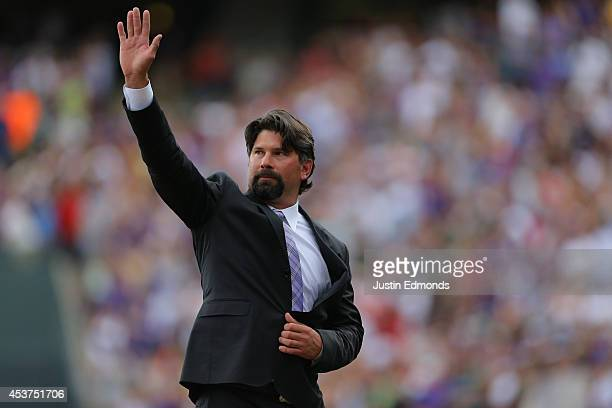 Former first baseman Todd Helton of the Colorado Rockies waves to the crowd during a ceremony to retire his number before a game against the...