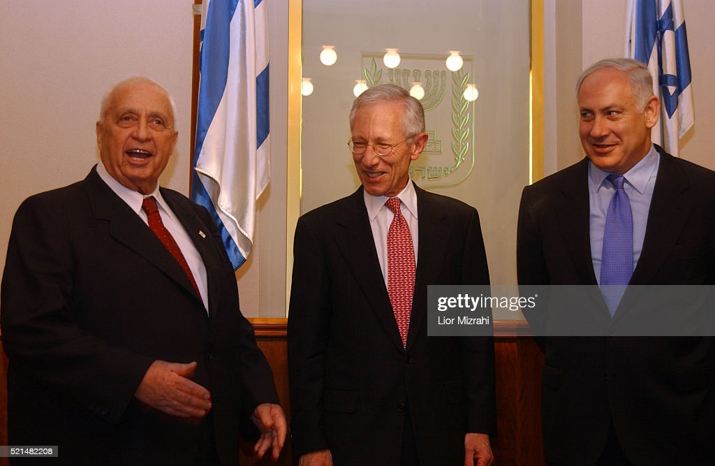 Former first deputy managing director of the International Monetary Fund (IMF), <a gi-track='captionPersonalityLinkClicked' href=/galleries/search?phrase=Stanley+Fischer&family=editorial&specificpeople=233518 ng-click='$event.stopPropagation()'>Stanley Fischer</a> (C), poses with Israeli Prime Minister Ariel Sharon (L) and Israeli Finance Minister Benjamin Netanyahu (R) for photographs in the Prime Minister's Jerusalem offices on Monday, 17 January 2005. Fischer is in Israel undergoing investigations to take over as Governor of the Bank of Israel, and was questioned yesterday by the Bach committee, which included his plans to immigrate to Israel. Fischer was deputy chairman of Citigroup and was tapped by the prime minister as governor-designate.