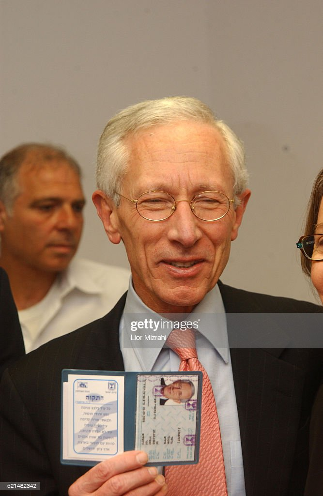 Former first deputy managing director of the International Monetary Fund (IMF), <a gi-track='captionPersonalityLinkClicked' href=/galleries/search?phrase=Stanley+Fischer&family=editorial&specificpeople=233518 ng-click='$event.stopPropagation()'>Stanley Fischer</a> holding his newly acquired Israeli ID at the Interior Ministry in Jerusalem on Sunday, May 01, 2005. Fischer, one of the world's leading economists and former deputy chairman of the Citigroup banking and insurance corporation, will be sworn in Sunday afternoon as governor of the Bank of Israel by President Moshe Katsav. Fischer, an American citizen, officially became an Israeli citizen Sunday morning, when he received his national identification card at the Interior Ministry in Jerusalem.
