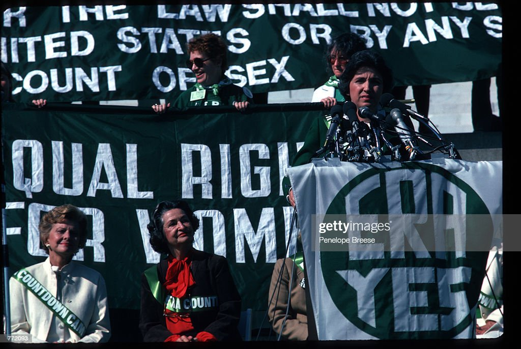 Former First Ladies Betty Ford and Lady Bird Johnson watch as NOW President Ellie Smeal speak at the 'Call to the Nation's Conscience' ERA rally on the steps of the Lincoln Memorial October 12, 1981 in Washington, DC. The Equal Rights Advocates (ERA) is dedicated to guaranteeing women equal opportunity and the rally was held on the final day of the NOW National Conference.
