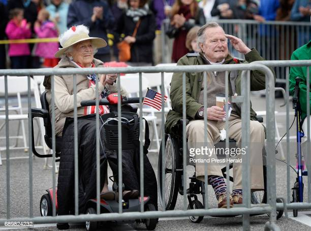 Former first lady Barbara Bush claps and former president George H W Bush salutes as the Memorial Day Parade in Kennebunkport goes by Monday May 29...