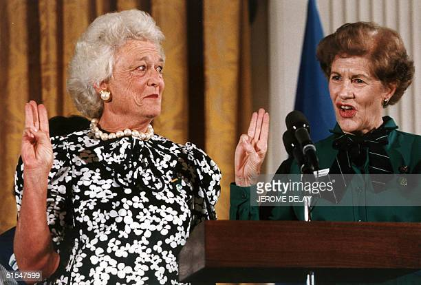 Former First Lady Barbara Bush gives the Girl Scout salute 28 June 1989 in this file photo as she was invested as the 14th national honorary...