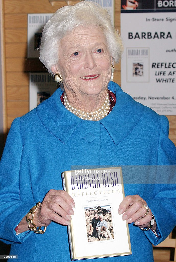 Former first lady Barbara Bush poses with a copy of her new book 'Reflection' at an in-store appearance at Borders Books November 4, 2003 in Westwood, California.