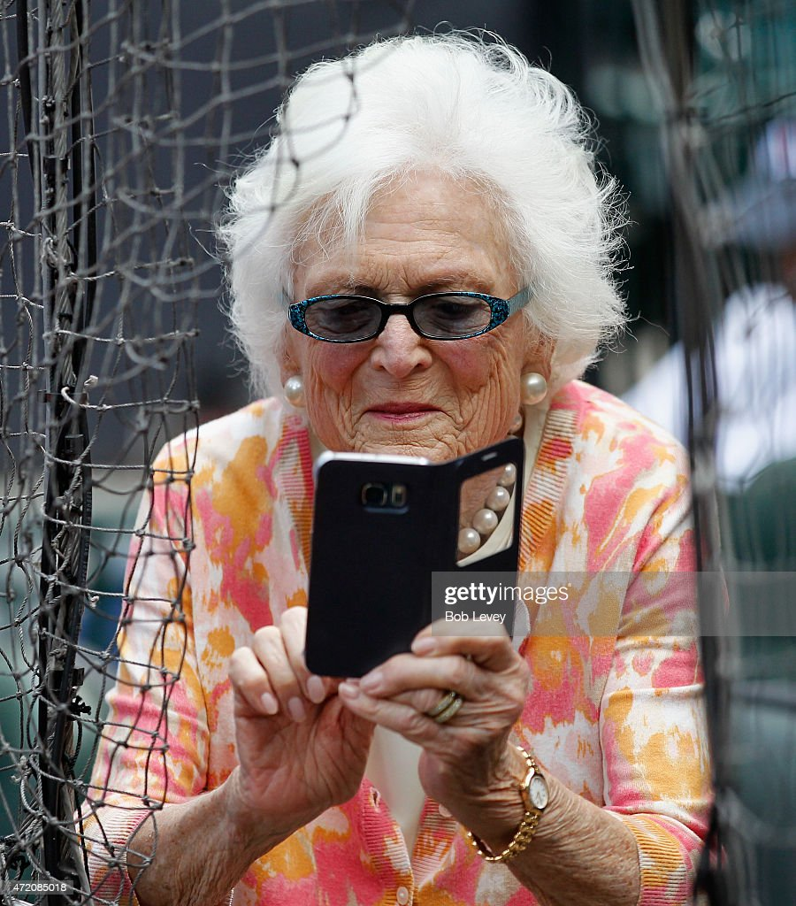 Former First Lady Barbara Bush takes a photo at Minute Maid Park on May 3 2015 in Houston Texas