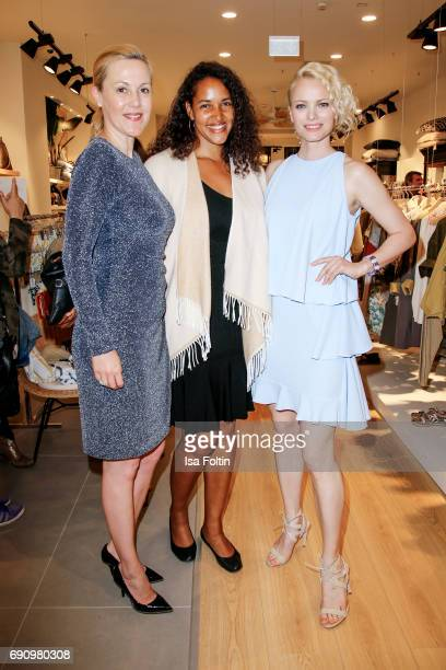 Former first Lady Bettina Wulff German singer Cassandra Steen and model Franziska Knuppe attend the Yargici Flagship Store Opening at Levantehaus on...