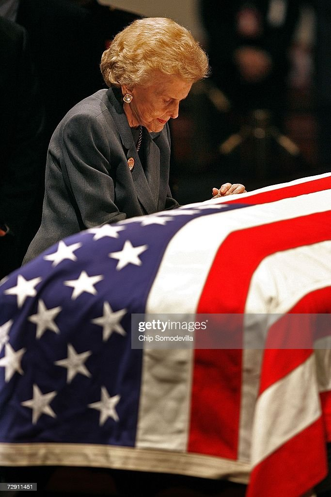 Former First Lady Betty Ford bows her head at the casket of her husband former US President Gerald R Ford as his remains lie in state in the Rotunda...