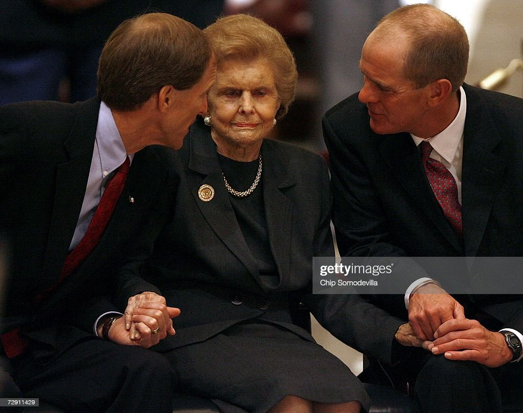 Former First Lady Betty Ford is comforted by her sons Michael Ford and Steve Ford while they sit in the Rotunda to view the casket of her husband and...