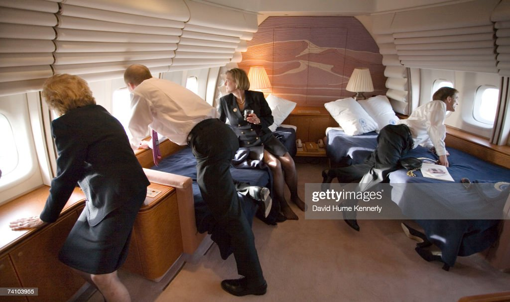 Former First Lady Betty Ford Steve Ford Susann Ford Bales and Mike Ford look at the window of the Presidential jet as it makes a low pass over the...