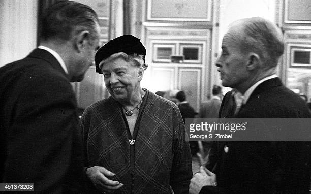 Former First Lady Eleanor Roosevelt center speaks with Averell Harriman left in New York 1958 The figure on the right is unidentified