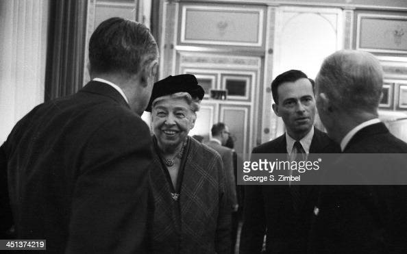 Former First Lady Eleanor Roosevelt second from left speaks with Averell Harriman left in New York 1958 The two figures on the right are unidentified
