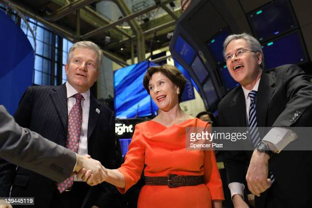 Former first lady Laura Bush shakes hands on the floor of the New York Stock Exchange while on a visit to Ring The Opening Bell on behalf of the The...