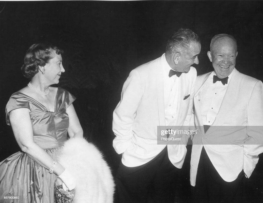 Former First Lady Mamie Eisenhower (1896 - 1979) smiles as Vice President Lyndon B Johnson (1908 - 1973) (center) shares a laugh with her husband, former President Dwight D Eisenhower (1890 - 1969) at a State Dinner, Mount Vernon, Virginia, July 11, 1961. The dinner was held in honor of President of Pakistan Muhammad Ayub Khan.