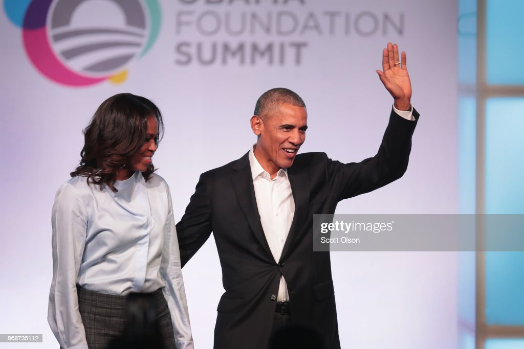 Former first Lady Michelle and former president Barack Obama are introduced at the inaugural Obama Foundation Summit on October 31, 2017 in Chicago, Illinois. The two-day event will feature a mix of community leaders politicians and artists exploring creative solutions to common problems, and experiencing art, technology, and music from around the world.