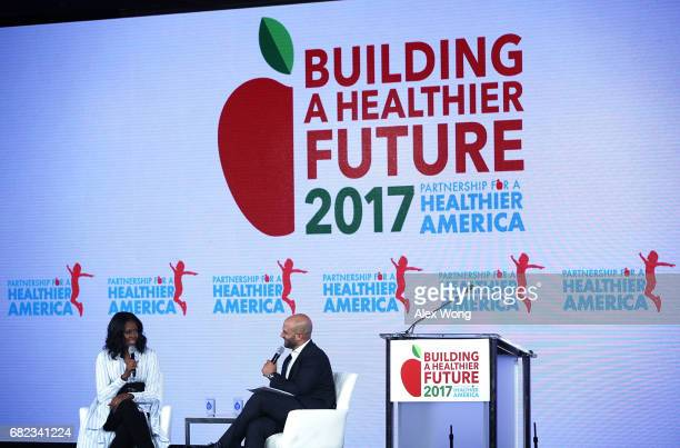 Former First Lady Michelle Obama participates in a discussion with former White House chef and Senior Policy Advisor for Nutrition Policy Sam Kass...