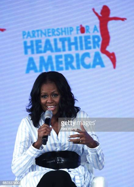 Former First Lady Michelle Obama speaks during the Partnership for a Healthier America Summit May 12 2017 in Washington DC The PHA held its summit to...