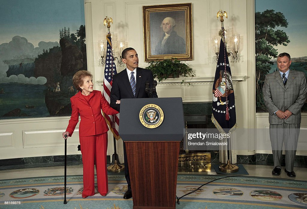 Former first lady <a gi-track='captionPersonalityLinkClicked' href=/galleries/search?phrase=Nancy+Reagan&family=editorial&specificpeople=93860 ng-click='$event.stopPropagation()'>Nancy Reagan</a> (L) and Rep. <a gi-track='captionPersonalityLinkClicked' href=/galleries/search?phrase=Dana+Rohrabacher&family=editorial&specificpeople=2337249 ng-click='$event.stopPropagation()'>Dana Rohrabacher</a> (R-CA) (R) listen while President <a gi-track='captionPersonalityLinkClicked' href=/galleries/search?phrase=Barack+Obama&family=editorial&specificpeople=203260 ng-click='$event.stopPropagation()'>Barack Obama</a> speaks during a bill signing in the Diplomatic Reception Room of the White House June 2, 2009 in Washington, DC. President <a gi-track='captionPersonalityLinkClicked' href=/galleries/search?phrase=Barack+Obama&family=editorial&specificpeople=203260 ng-click='$event.stopPropagation()'>Barack Obama</a> signed the ' Ronald Reagan Centennial Commission Act' which is intended to honor the former US President Ronald Reagan on his 100th birthday in 2011.