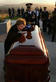 Former first lady Nancy Reagan leans into the casket of former President Ronald Reagan during the interment ceremony at the Ronald Reagan...