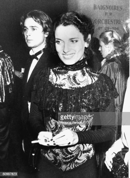 Former First Lady of Canada Margaret Trudeau estranged wife of Pierre Trudeau smiles and holds a cigarette at the gala opening of the International...