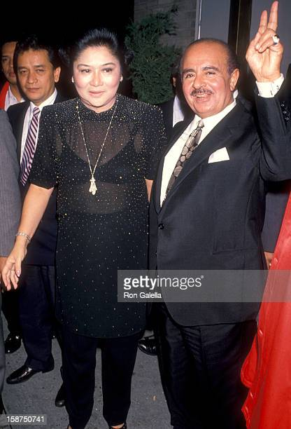 Former First Lady of the Philippines and businessman Adnan Khashoggi attend Imelda Marcos' 61st Birthday Party on July 2 1990 at The Nile Restaurant...